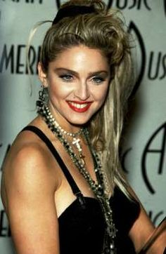 Red lipstick to Madonna = the makeup equivalent of her cone bra. - Provided by Marie Claire