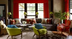 The living room of a queen anne home in Tuxedo Park, New York, decorated by Jeffrey Bilhuber; green accent, zebra, red