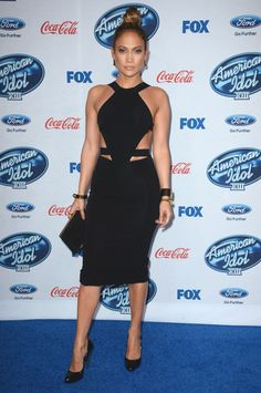"""Of course Jennifer Lopez's take on a regular LBD is this sexy. She wore a black pencil dress with side cutouts for FOX's """"American Idol XIII"""" finalists party in Los Angeles on Feb. 20, 2014."""