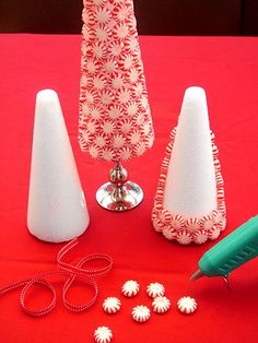 Peppermint Trees  Peppermints, Styrofoam cones, hot glue, ribbon and maybe some candlesticks too