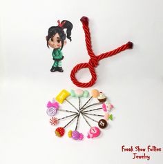 Vanellope Von Schweetz inspired cosplay hair pins with twizzler hair tie set by FreakShowFollies on Etsy https://www.etsy.com/listing/203756827/vanellope-von-schweetz-inspired-cosplay