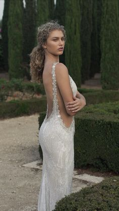 Our is a glamorous fitted mermaid dress has sheer cutouts and is made of a unique lace which is embroidered with intricate beads and crystal fringes. There is additional crystalized embroidery adorning the plunging v neckline. Amazing Wedding Dress, Top Wedding Dresses, Lace Mermaid Wedding Dress, Wedding Dress Trends, Mermaid Dresses, Designer Wedding Dresses, Bridal Dresses, Lace Wedding, Unique Wedding Dress