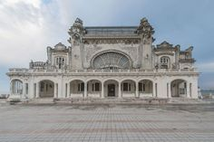 """According to photographer Romain Veillon: """"During a recent trip to Romania, I had the chance to shoot the abandoned casino in Constanta. As a pearl watching… Old Buildings, Abandoned Buildings, Abandoned Places, Abandoned Castles, Constanta Romania, Haunted Places, Abandoned Mansions, Bored Panda, Old Houses"""