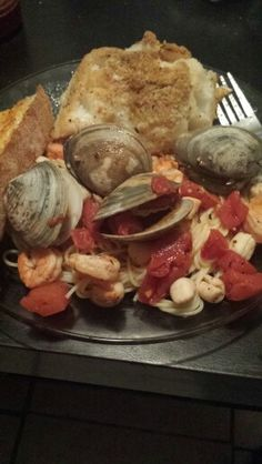 Seafood pasta  1/2 lb steamers  1/2 lb shrimp  1/2 lb bay scallops  2 tomatoes diced  1/2 bunch basil   1/4 cup red wine vinegar  2 tbs butter  I garlic clove minced    Place all ingredients in a pan or a pot cook on med heat until steamers open
