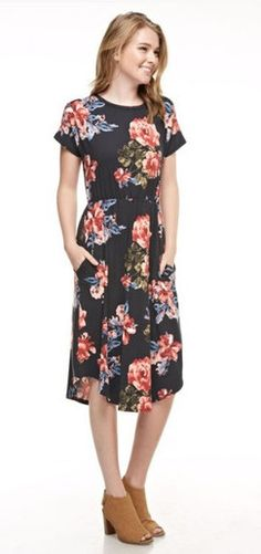 Cute modest floral knee length dress with pockets. Trendy contemporary fashion.