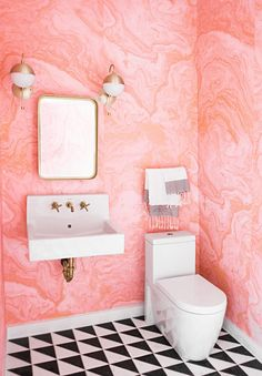 You can't go wrong with marbling in any space in your home, especially when it comes in this fancy shade of coral pink in a bathroom.