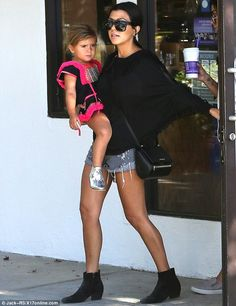 Park time: Kourtney Kardashian carried her daughter Penelope on Saturday for a family trip to a park in Malibu, California