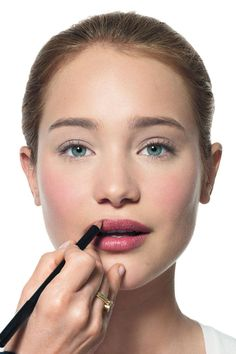 """Add extra definition to lips by lining after you apply your lipstick. """"Don't go outside of the lip line; it doesn't look natural,"""" Brown says. - ELLE.com"""
