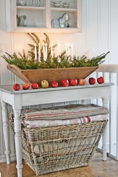 VIBEKE DESIGN.  Love the greenery and candles and basket full of quilts.