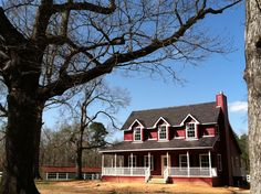 Big Red House + White Porch = Near Perfection (Just add a rocker) → #WeBuildForLife #UBH