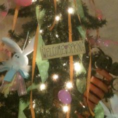 Use your Christmas tree year round!  I decorated my primitive tree for Easter! It's easy to coordinate ribbon, eggs and just a few spring ornaments. Put it in your entry way so it's the first thing your guest see! - Nicole Castle