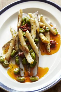 Steamed razor clams with chorizo and broad beans