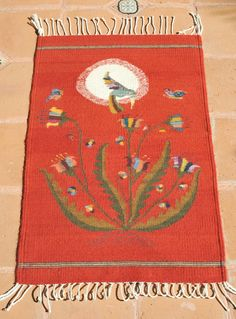 https://flic.kr/p/rUWwyG | Hummingbird Weaving Oaxaca Mexico | This wool tapete or rug features a feeding hummingbird and comes from the taller of weaver Bulmaro Perez of Teotitlan del Valle, Oaxaca