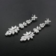"""""""Get the sparkle you crave with these modern cubic zirconia drop earrings.  Perfect for bridal, prom or any special occasion.  2.5"""" long.  Style T5735E.…"""""""