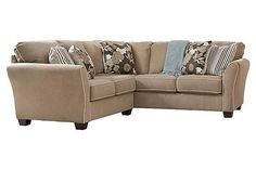 """The Cahal - Flax Sectional from Ashley Furniture HomeStore (AFHS.com). With the stylish flared arms and supportive boxed back and seat cushions adorned with decorative contrast welting, the """"Cahal-Flax"""" upholstery collection beautifully captures a rich contemporary style while offering the comfort and inviting atmosphere that fits perfectly into any living area."""