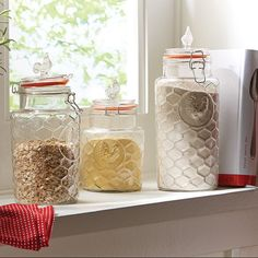 Your kitchen can get its own fresh breath of spring with the easy addition of a few key pieces. Place a set of country chic canisters on your countertop (they pull double duty with storage capability too!), replace your kitchen mat with one in a fresh floral print in front of your sink, and add an herb garden to your windowsill.