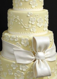 Indian Weddings Inspirations. Yellow cake. Repinned by #indianweddingsmag…