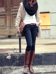 Beige coat, white shirt, scarf, and boots.