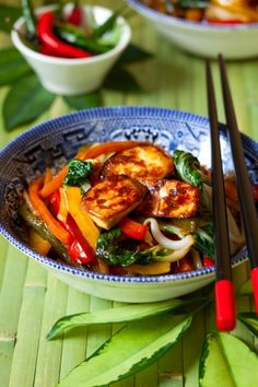 Stir-fried tofu and veggies contain magnesium which can improve your mood. Get magnesium (recommended daily intake is 310 mg) from foods like nuts, seeds, dark-green vegetables (a half-cup of cooked spinach has 75 mg), unrefined grains, and soy. Avoid caffeine and alcohol since they can often deplete