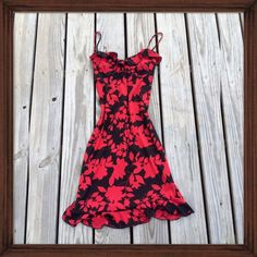 Black and Red Ruffled Dress Drop jaws in this black and red ruffle hemmed dress. This formfitting dress was worn only once and is in perfect condition. Dresses