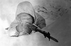 "Simo Häyhä, also known as ""The White Death"" posing with his winter camouflage, 1940. He is reported to have killed 505 men during 1939-40 winter war against the Soviet Red army. The highest number of sniper kills in any major war. Location: Ladoga's Karelia, Finland."