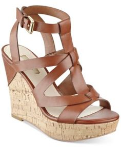 fe4244b14f4 ... caged details and cork platform wedge on these Harlea sandals from Guess.