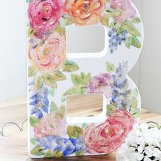 Create a beautiful monogram watercolor canvas filled with DIY watercolor roses, hyacinths and leaves using this step-by-step tutorial. Watercolor Canvas, Watercolor Rose, Felt Roses, Felt Flowers, Lace Flowers, Wreath Crafts, Diy Crafts, Decor Crafts, Diy Monogram