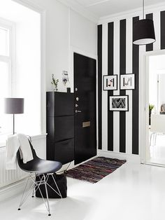 Via Stadshem | Black and White Hallway | Ikea | Eames Chair