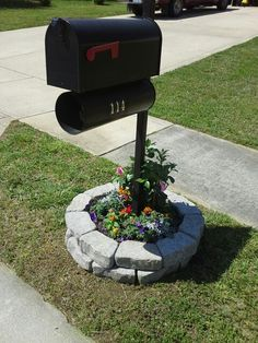 Mailbox raised planter. Simply stack 2 rows of 10 to 15 landscape bricks and fill with garden soil. Plant with desired plants (preferably with a climbing vine) and tada! I used a mandavilla, petunias, marigolds, dusty miller and celosia (cockscomb)...