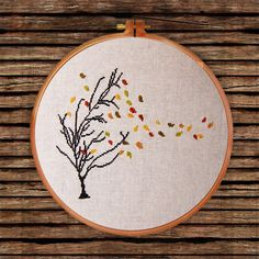 Autumn Tree cross stitch pattern falling leaves easy natural beauty design Tree falling leaves in the wind is beautiful natural scenery. This autumn tree cross stitch pattern is easy to stitch, and extremely adorable when finished. Fall Cross Stitch, Cross Stitch Tree, Simple Cross Stitch, Cross Stitching, Cross Stitch Embroidery, Embroidery Patterns, Hand Embroidery, Modern Cross Stitch Patterns, Cross Stitch Designs