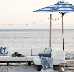 Round Wooden Umbrella for the outdoor part of your beach house.