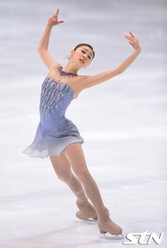 Grayish blue dress with nude mesh yoke, a spray of sequins on the neckline and another on the bodice, and underskirt effect Figure Skating Quotes, Figure Skating Outfits, Figure Skating Costumes, Ice Dance Dresses, Ice Skating Dresses, Skating Pictures, Kim Yuna, Skateboard Girl, Gymnastics Girls