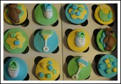 Decorated orange boy baby shower cupcakes