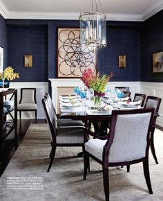 Love the deep blue walls for dining. The white wainscoting softens the effect. Love the room!