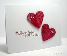 handmade Valentine card from Simplicity ...two die cut hearts and a sentiment form a love triangle ... clean a simple perfection!!