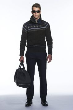 Banana Republic F'13 RTW --Where is he going with that huge duffel bag??  Nice sweater,  tie, and specs combo--