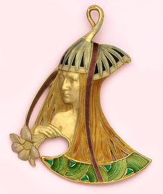 Extremely rare enamel, carved gold and emerald pendant   of a woman with flowers. Vever, Paris. Vever was one of the great   Art Nouveau jewelers during the heyday of the French Art Nouveau   movement. His 3 volume book on Art Nouveau jewelry is a classic.