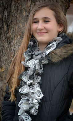 Black & White. One of the hottest new trends in knitting/crocheting is the ruffle yarn scarf.