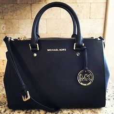 Michael Kors purse. I like the black.