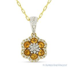 The featured pendant is cast in 14k yellow & white gold and showcases a finely crafted flower design adorned with round cut citrine gemstones and round cut diamond accents.