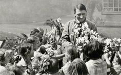 Hitler being swarmed by flower-bearing children.