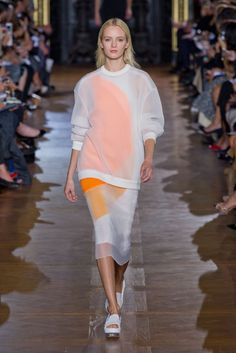 Stella McCartney teams a tailored dress with a sheer baggy jumper for a tailored sport chic aesthetic