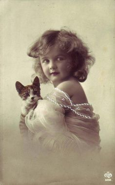 Girl with kitten, ca. 1910s. (tinted real photo postcard)