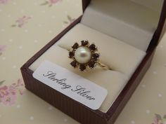 A beautiful 925 silver gilt vintage jewelry dress ring set with a pearl in it's center surrounded by sparkly round garnet faceted stones by vintagejewelleryetc on Etsy https://www.etsy.com/listing/493497295/a-beautiful-925-silver-gilt-vintage