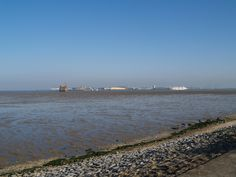 A view across the mouth of the Medway towards Sheerness from the sea front at Grain , Kent  [shared]