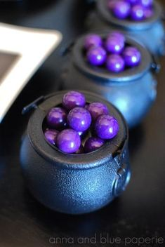 Mini cauldrons filled with candy
