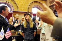 Sawyer Fredericks, winner of The Voice, center, receives recognition in the Assembly Chamber on Tuesday, June 9, 2015, at the Capitol in Albany, N.Y. Fredericks was the guest of Assemblyman Angelo Santabarbara, left. (Cindy Schultz / Times Union) Photo: Cindy Schultz / 00032213A