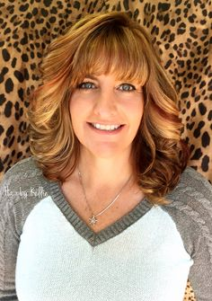 Long layered haircut , red blond and chocolate Haircolor