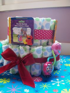 decorated baby cakes ideas | unique baby shower diaper cake includes items such as board books ...
