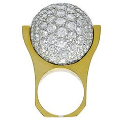 """Very dramatic large cocktail ring. Over 10 cts. of brilliant diamonds set in 18k yellow gold. The """"diamond ball"""" spins completely around. Size 5 3/4 and can be sized. An extremely showy and entertaining piece of jewelry. Great fun to wear."""